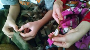 Many Hands Make Light Work as Grandchildren make Blankets too!  (c) 2015 Patricia J. Angus