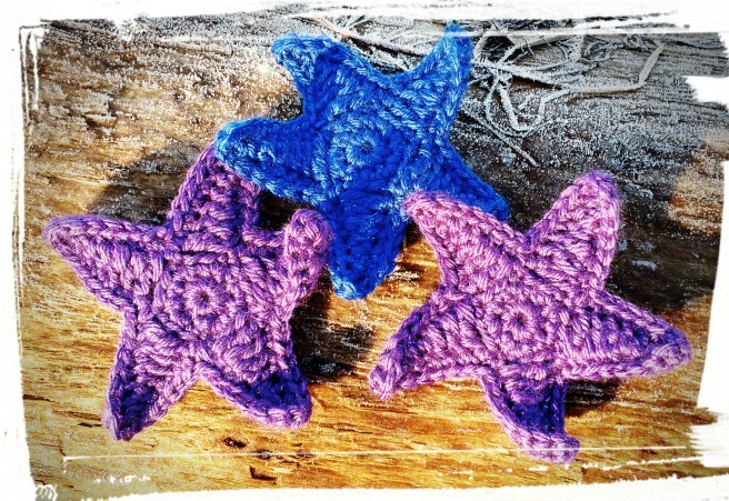 Crocheted Starfish on a Frosty Log. (c) 2017 Patricia J. Angus